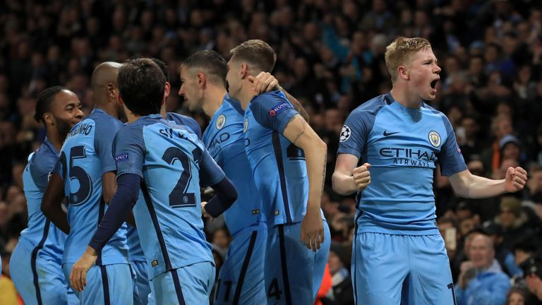 Manchester City's Kevin De Bruyne (right) celebrates with team mates after scoring his sides second goal of the game during the UEFA Champions League match