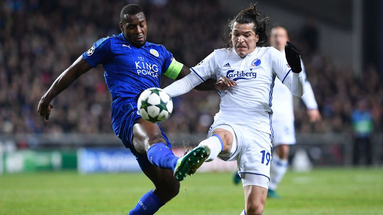Leicester City defender Wes Morgan vies with Federico Santander