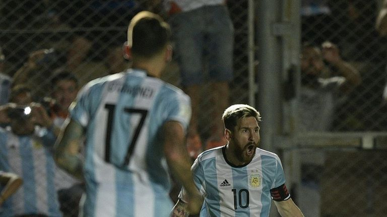 Argentina's Lionel Messi celebrates with team-mates after scoring against Colombia