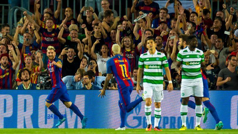 Lionel Messi celebrates after he scores his side's opener against Celtic in September
