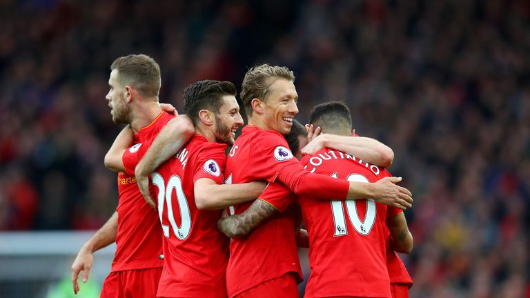Philippe Coutinho of Liverpool celebrates with team-mates after scoring