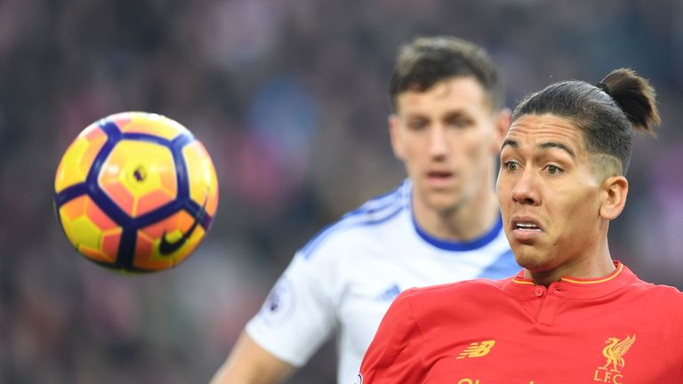 Liverpool's Brazilian midfielder Roberto Firmino eyes the ball during the English Premier League football match between Liverpool and Sunderland at Anfield
