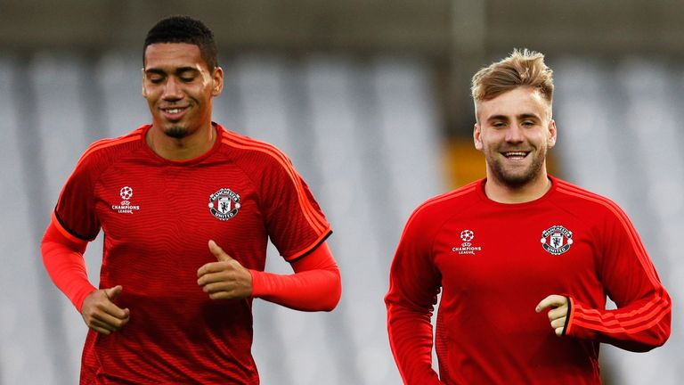 BRUGGE, BELGIUM - AUGUST 25:  Chris Smalling and Luke Shaw of Manchester United warm up during the Manchester United training session held at Jan Breydel S