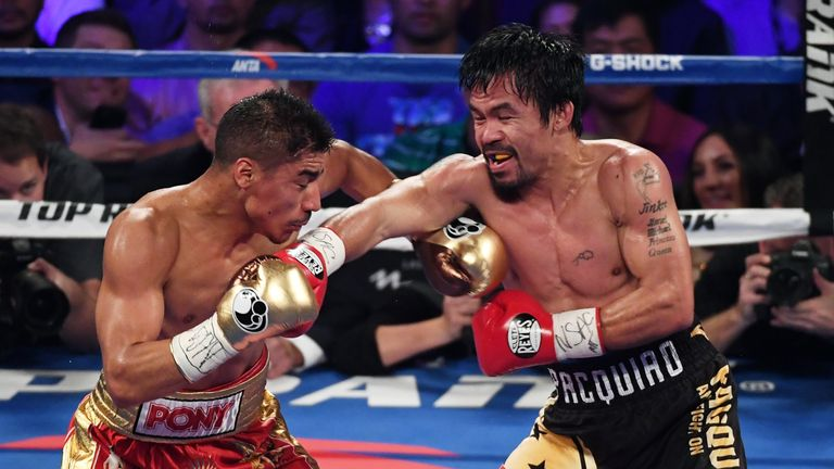 LAS VEGAS, NV - NOVEMBER 05:  Jessie Vargas (L) and Manny Pacquiao battle in the third round of their WBO welterweight championship fight at the Thomas & M