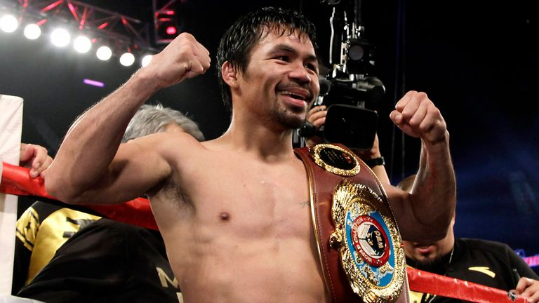 Manny Pacquiao poses with the WBO welterweight title belt after his win over Jessie Vargas in Las Vegas