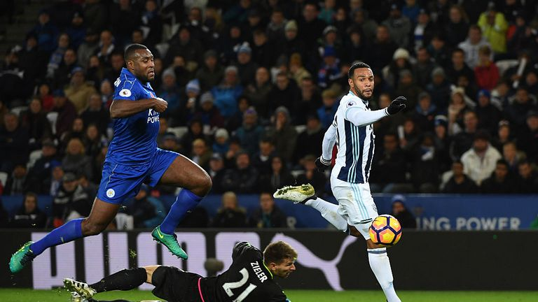 LEICESTER, ENGLAND - NOVEMBER 06:  Wes Morgan of Leicester City closes down Matt Phillips of West Bromwich Albion as he chips Ron-Robert Zieler of Leiceste