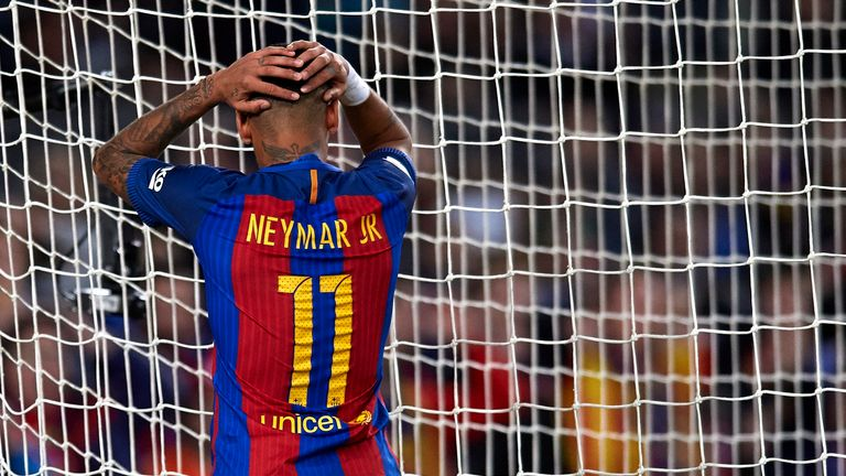 Neymar reacts as he fails to score during the La Liga match against Malaga