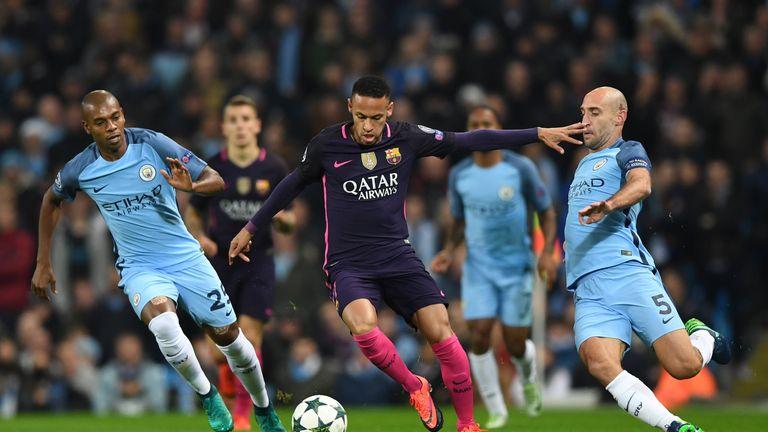 MANCHESTER, ENGLAND - NOVEMBER 01:  Neymar of Barcelona (C) is put under pressure from Fernandinho of Manchester City (L) and Pablo Zabaleta of Manchester
