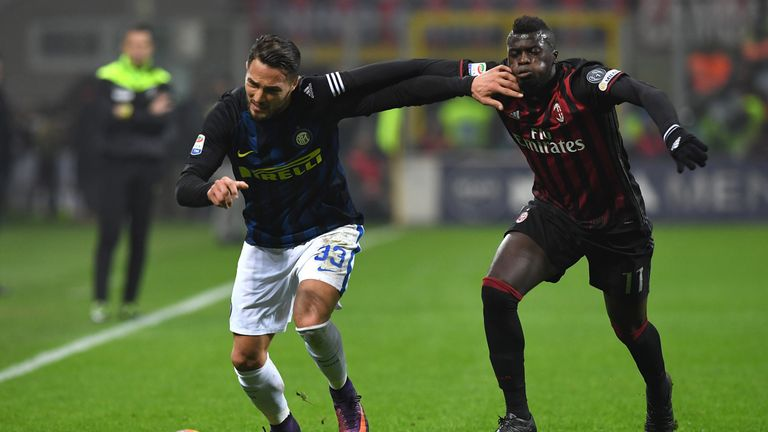 Mbaye Niang (R) clashes with Danilo D'Ambrosio