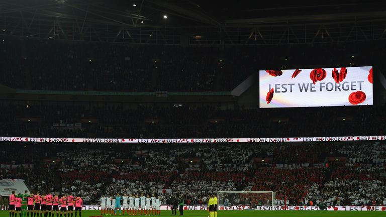 Players, officials and fans observe a silence in remembrance of Armistice Day prior to the FIFA 2018 World Cup qualifying m