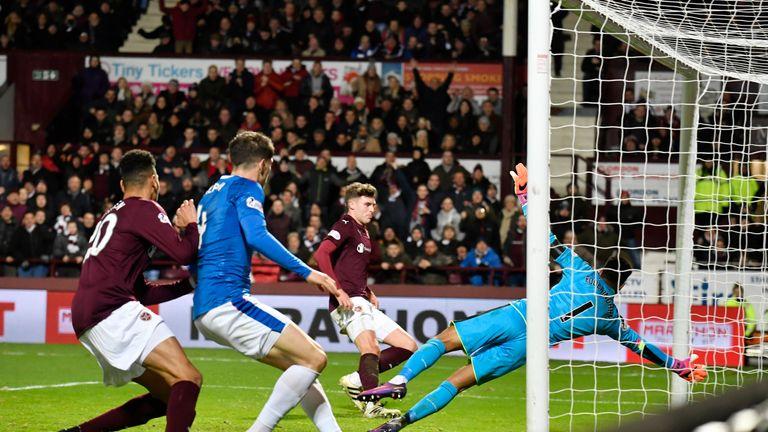 Robbie Muirhead (far side) scores for Hearts in Robbie Neilson's last match as boss against Rangers