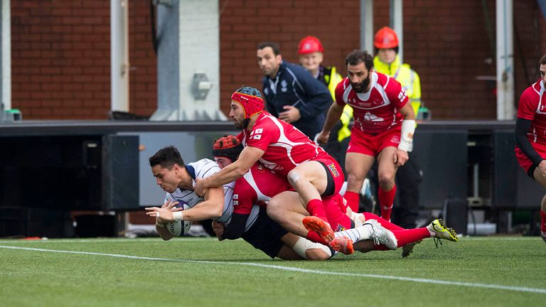 Scotland wing Sean Maitland dives over to score their third try