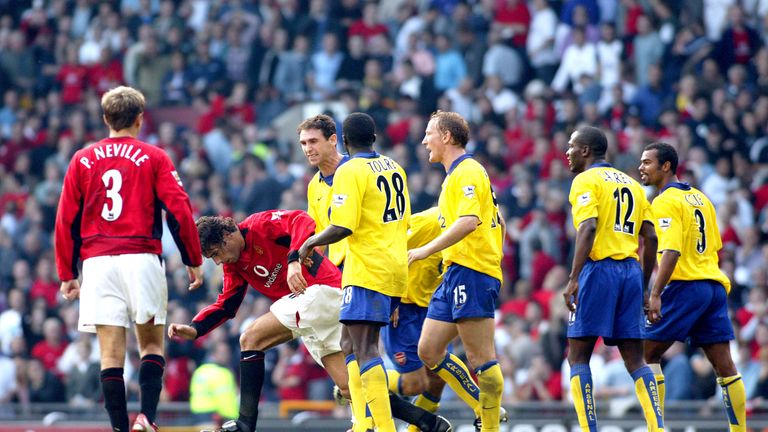 Martin Keown and Ray Parlour taunt Ruud van Nistelrooy following his penalty miss in 2003