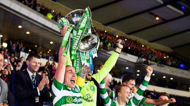 Celtic captain Scott Brown lifts the League Cup at Hampden