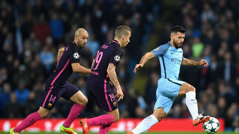 MANCHESTER, ENGLAND - NOVEMBER 01: Sergio Aguero of Manchester City (R) is chased down by Lucas Digne of Barcelona (C) and Javier Mascherano of Barcelona (