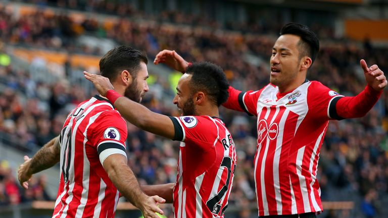 Charlie Austin is congratulated after scoring a penalty against Hull