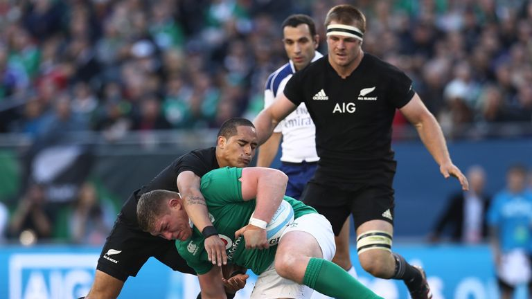 Tadhg Furlong is tackled by Aaron Smith