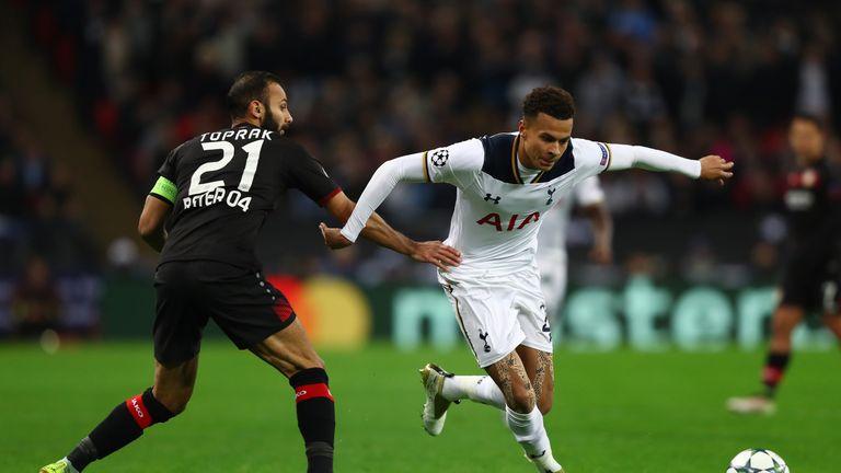 LONDON, ENGLAND - NOVEMBER 02:  Dele Alli of Tottenham Hotspur skips past Omer Toprak of Bayer Leverkusen during the UEFA Champions League Group E match be