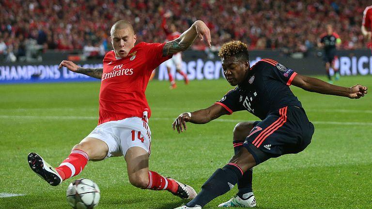 Victor Lindelof of Benfica challenges David Alaba of Bayern Muenchen