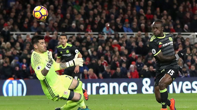 MIDDLESBROUGH, ENGLAND - NOVEMBER 20: Victor Moses of Chelsea has a shot saved by Victor Valdes of Middlesbrough  during the Premier League match between M
