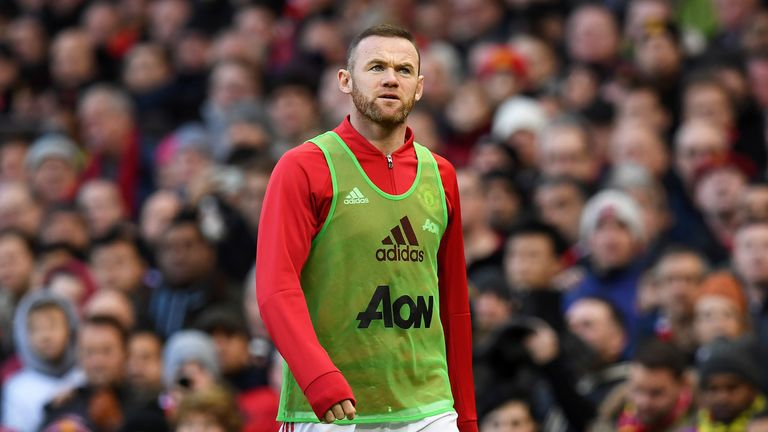 Wayne Rooney warms up on the touchline at Old Trafford