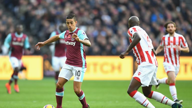 Manuel Lanzini of West Ham United takes on Bruno Martins Indi of Stoke