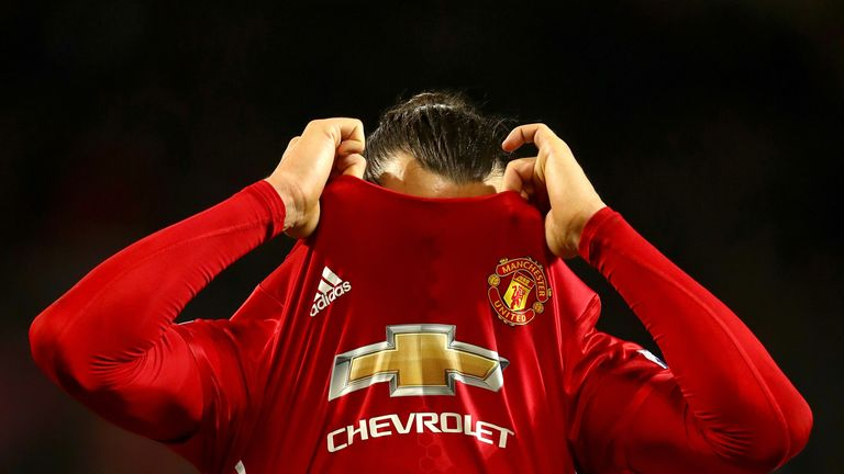 MANCHESTER, ENGLAND - NOVEMBER 27: Zlatan Ibrahimovic of Manchester United takes his shirt off after the final whistle during the Premier League match betw