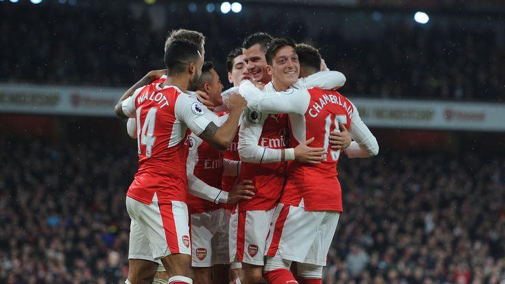 Arsenal celebrate a goal against Stoke City at Emirates Stadium on December 10, 2016