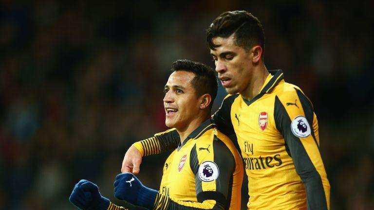 Alexis Sanchez of Arsenal celebrates with Gabriel Paulista after scoring his team's second goal during the Premier League match at West Ham