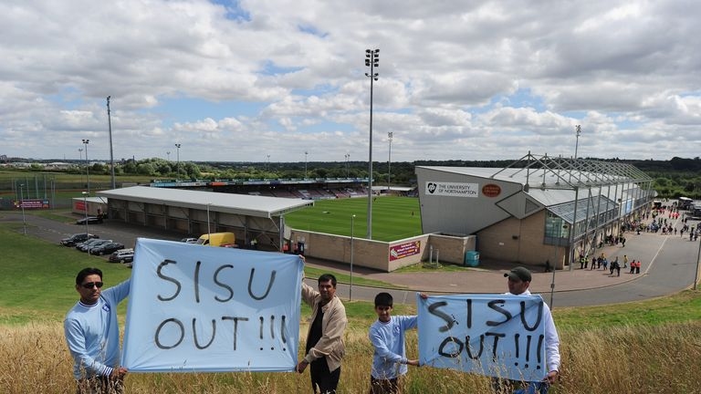 NORTHAMPTON, ENGLAND - AUGUST 11 2013:  Coventry City fans protest before the League One match between Coventry City and Bristol City at Sixfields Stadium
