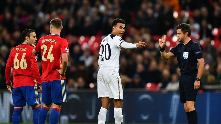 Dele Alli of Tottenham Hotspur (C) argues with the referee during the UEFA Champions League Group E match between Tottenham and CSKA Moscow