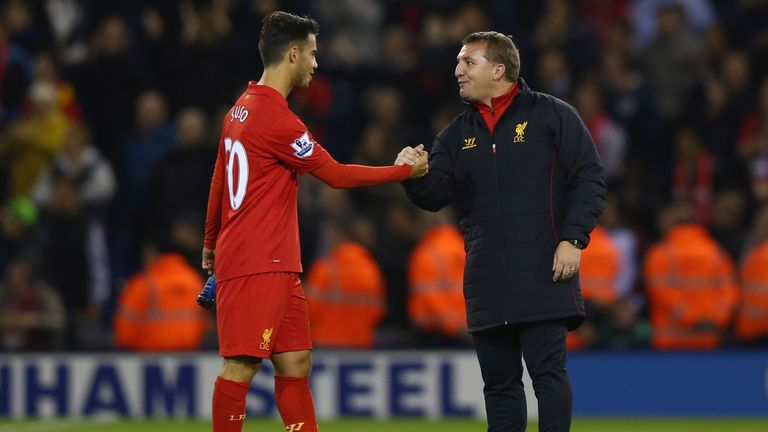 WEST BROMWICH, ENGLAND - SEPTEMBER 26 2012: Suso of Liverpool shakes hands with manager Brendan Rodgers after their Capital One Cup victory over West Brom