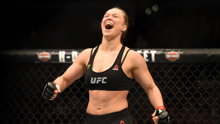 LOS ANGELES, CA - FEBRUARY 28:  Ronda Rousey celebrates her victory over Cat Zingano in their UFC women's bantamweight championship bout during the UFC 184
