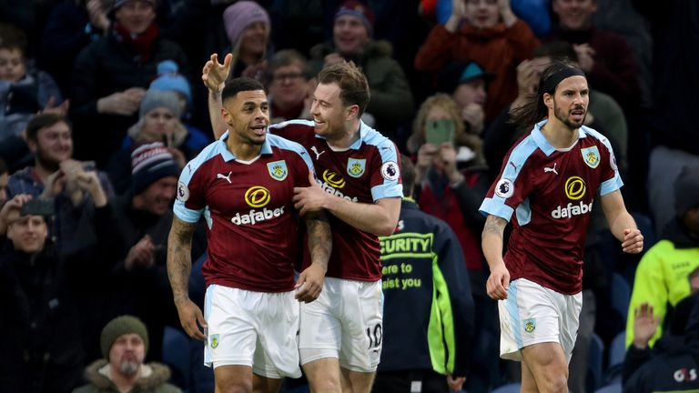Andre Gray (L) celebrates giving Burnley the lead