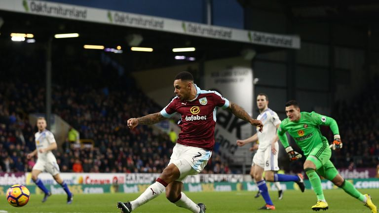 Andre Gray (C) scores his second goal of the game for Burnley