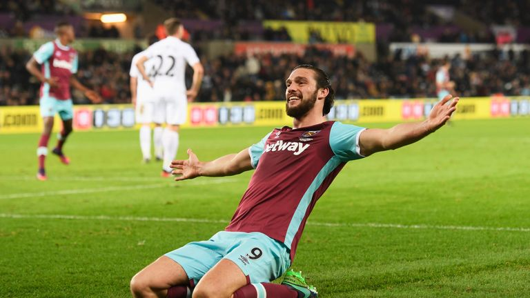 Andy Carroll celebrates scoring his team's fourth goal