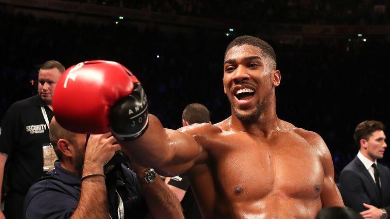 Anthony Joshua celebrates after beating Eric Molina during their IBF World Heavyweight Championship bout
