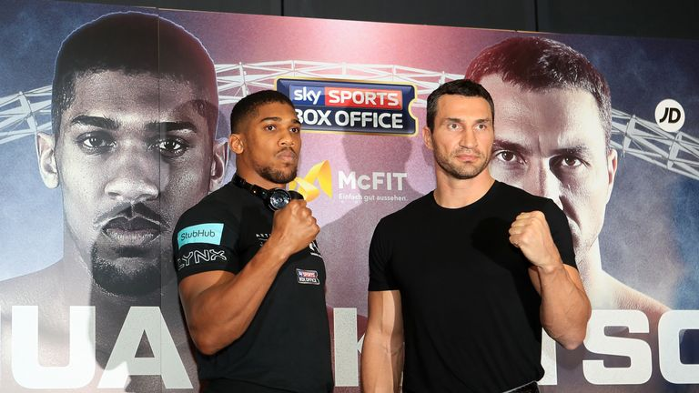 Anthony Joshua and Wladimir Klitschko pose for a photograph during the press conference at Wembley Stadium