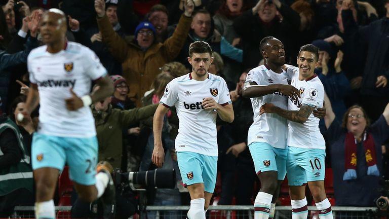 LIVERPOOL, ENGLAND - DECEMBER 11:  Michail Antonio (2nd R) of West Ham United celebrates scoring his team's second goal with his team mates Manuel Lanzini