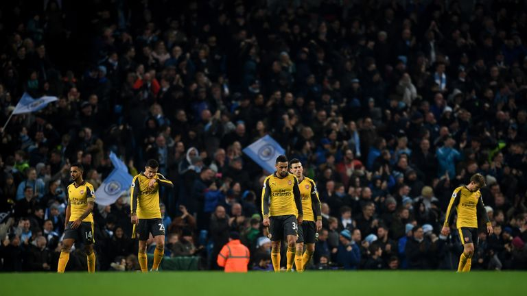 MANCHESTER, ENGLAND - DECEMBER 18: The Arsenal team are dejected after Manchester City score their second goal of the game during the Premier League match