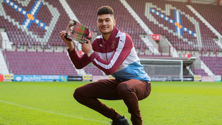 Hearts' Bjorn Johnsen shows off the Scottish Premiership player of the month award for November