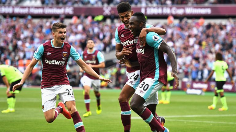 LONDON, ENGLAND - AUGUST 21:  Michail Antonio (#30) of West Ham United celebrates scoring the opening goal with team mates Ashley Fletcher and Sam Byram (L