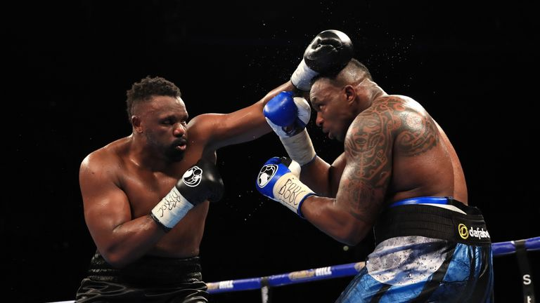 MANCHESTER, ENGLAND - DECEMBER 10:  Dillian Whyte (R) of Brixton in action against Dereck Chisora of Finchley during their WBC World Heavyweight Title Elim