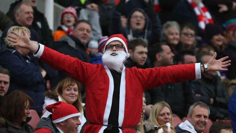 a supporter gets into the christmas spirit - Football Christmas Eve