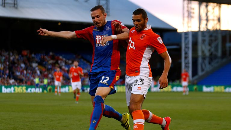 Crystal Palace's Jordon Mutch (left) and Blackpool's Colin Daniel battle for the ball during the EFL Cup, Second Round match at Selhurst Park, London.