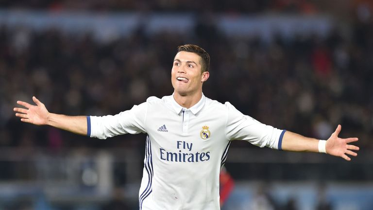 Real Madrid forward Cristiano Ronaldo celebrates scoring during extra-time of the Club World Cup football final match between Kashima Antlers of Japan and
