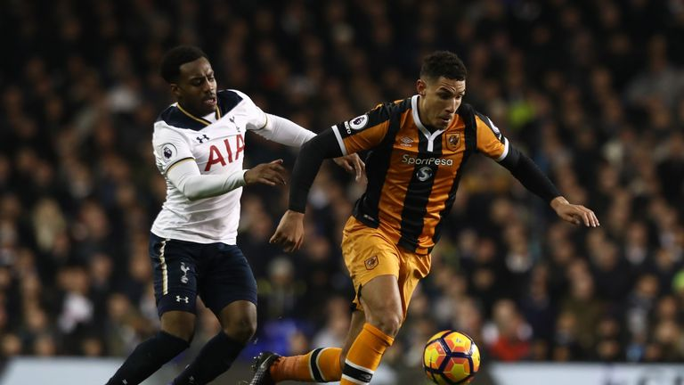 LONDON, ENGLAND - DECEMBER 14: Jake Livermore of Hull City and Danny Rose of Tottenham Hotspur compete for the ball during the Premier League match between