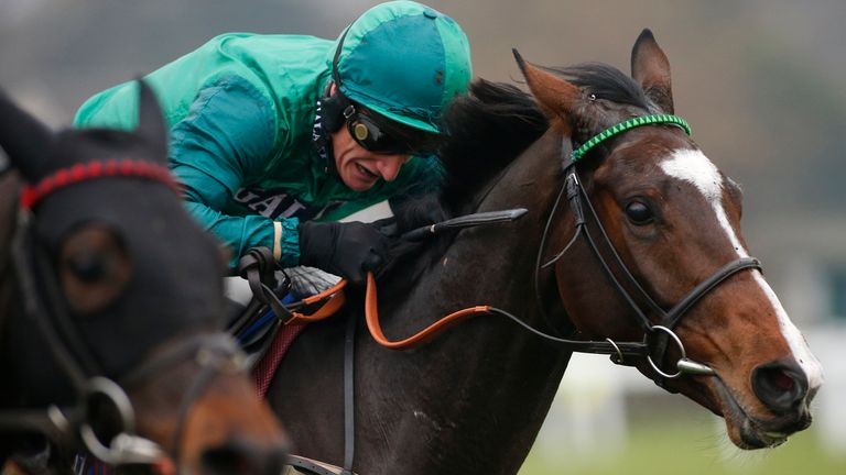 Daryl Jacob gets Messire Des Obeaux up to win the Neptune Investment Mangement Novices' Hurdle at Sandown.