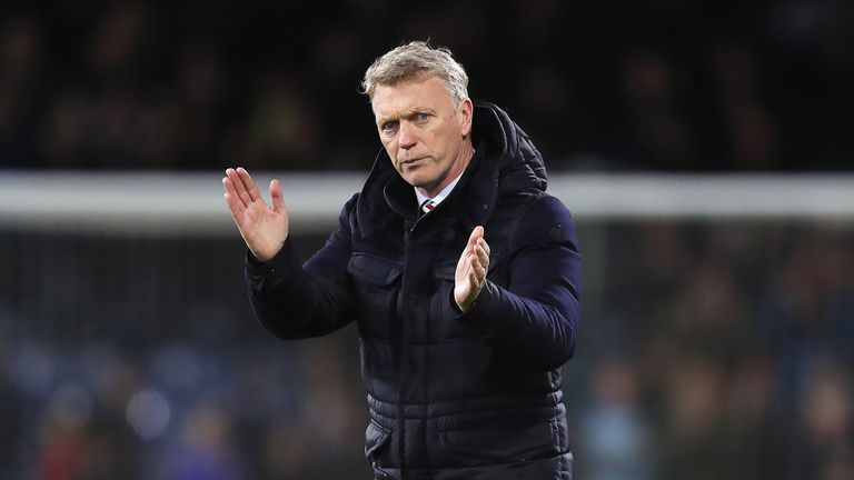 A despondent David Moyes applauds fans after the 4-1 loss to Burnley