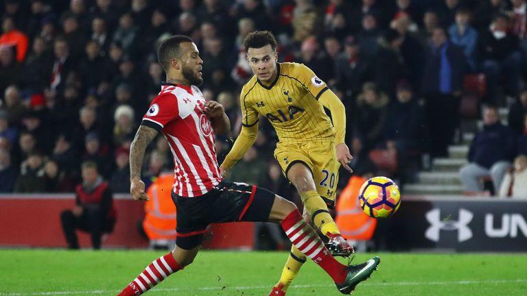 Dele Alli of Tottenham Hotspur shoots past Ryan Bertrand of Southampton as he scores their fourth goal during the Premier League clash